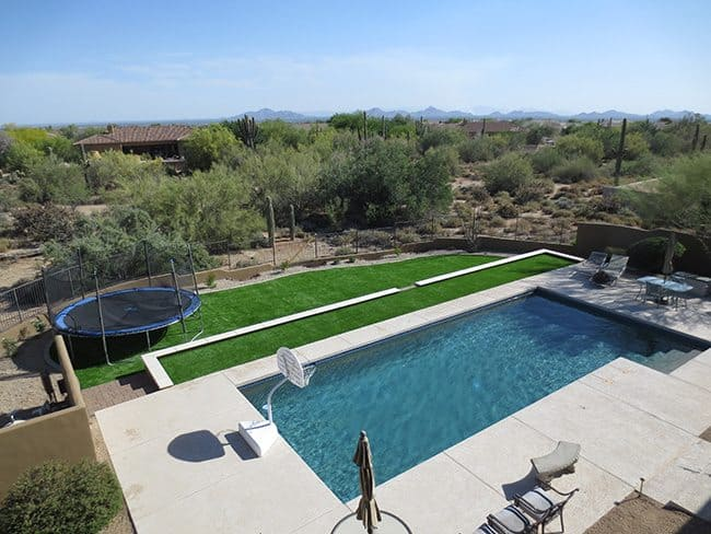 Artificial Grass with Trampoline in Care Free, AZ